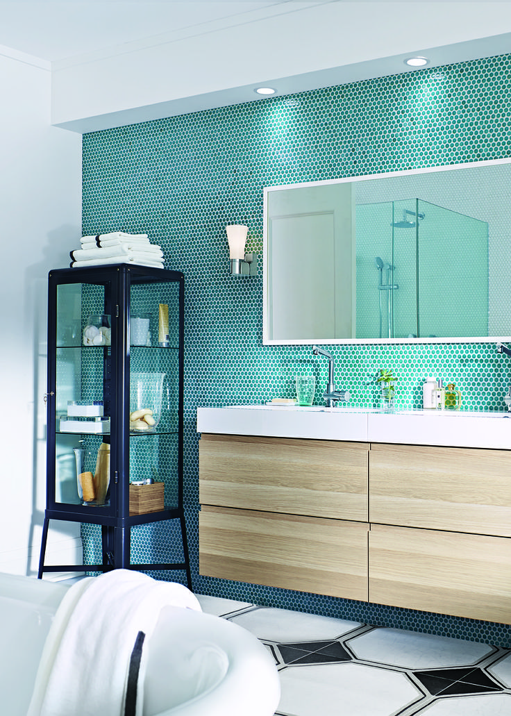 Ikea used World Mosaic's penny rounds in turquoise for a bathroom feature wall. Looks fabulous!