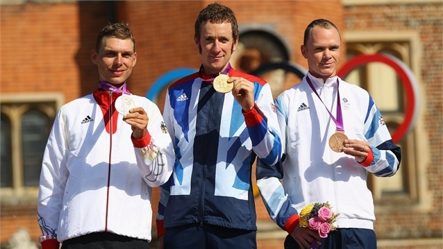 (L-R) Silver medallist Tony Martin of Germany, gold medallist Bradley Wiggins of Great Britain and bronze medallist Christopher Froome of Great Britain celebrate during the Victory Ceremony after the men's Individual Time Trial Road Cycling