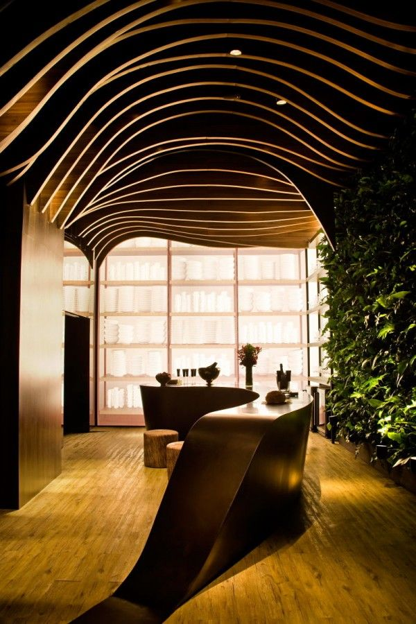 Beautiful organic shapes. The ceiling looks amazing combined with the green wall.