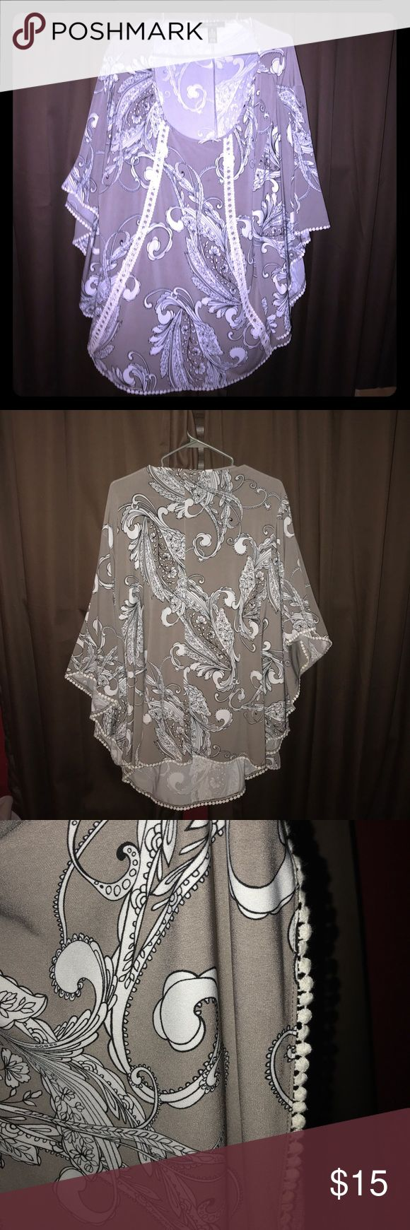 Style & co flowing blouse. Gray with floral print Style & co flowing blouse. Gray with floral print. This a beautiful top. Flows and flatters the figure. Wore only a few times. Lots of compliments. Made very well. Arms are winged. Fabric is breathable and is high quality. Shirt is in great condition Style & Co Tops Blouses