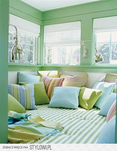 Amazing book nook - love the colours, pillows, light