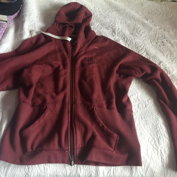 Maroon Nike sports jacket Maroon Nike jacket, XL, long sleeve, a little mark on it- that should come off after washing it, worn a few times, a little bit of rubbing on the under arms Nike Jackets & Coats