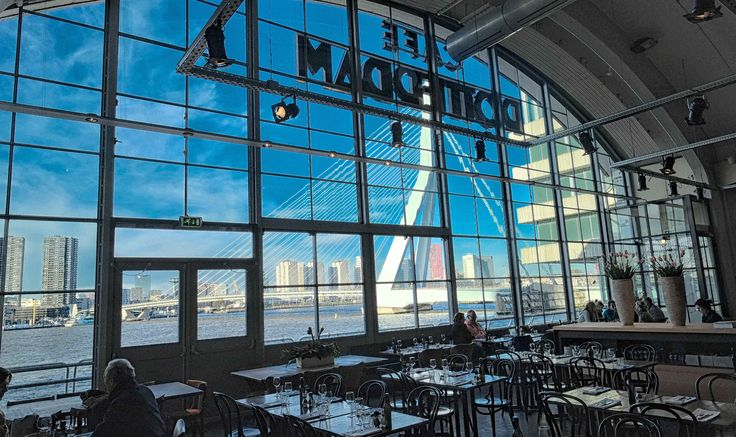 After years of renovation, Café Rotterdam finally opened it's doors again. Located in the Cruise Terminal of Rotterdam you can have a drink or bite (pizza) with stunning view over the river. Café Rotterdam, Zuid-Holland #restaurant #eat #drink #café #thisisnhow #tourism #rotterdam