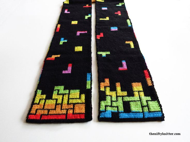 Tetris is one of my all time favorite games. Something about how the blocks fit together speaks to me. I designed the Tetris Prism Scarf to feature a Tetris game on both ends, with falling blocks along the length of the scarf. Each end has two different possible designs you can choose to knit, for either a well played game or a poorly played game! I imagine it as two people playing a Tetris battle.  Double knit, this scarf is fully reversible, featuring opposite color schemes on each side…
