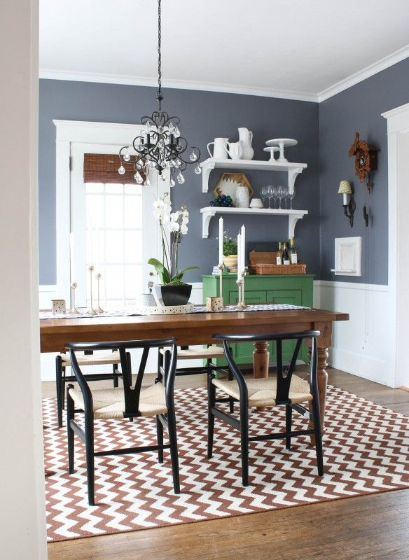 From My Home to Yours: Livable Color. Soothing slate blue walls with a warm brown chevron rug in a dining room.