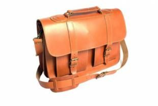 A classic calfskin caramel leather satchel – perfect for books and laptops. Two front pockets, two internal compartments and one zipped back pocket. Long, adjustable shoulder strap. 33 x 39.5 x 13.5 cm.