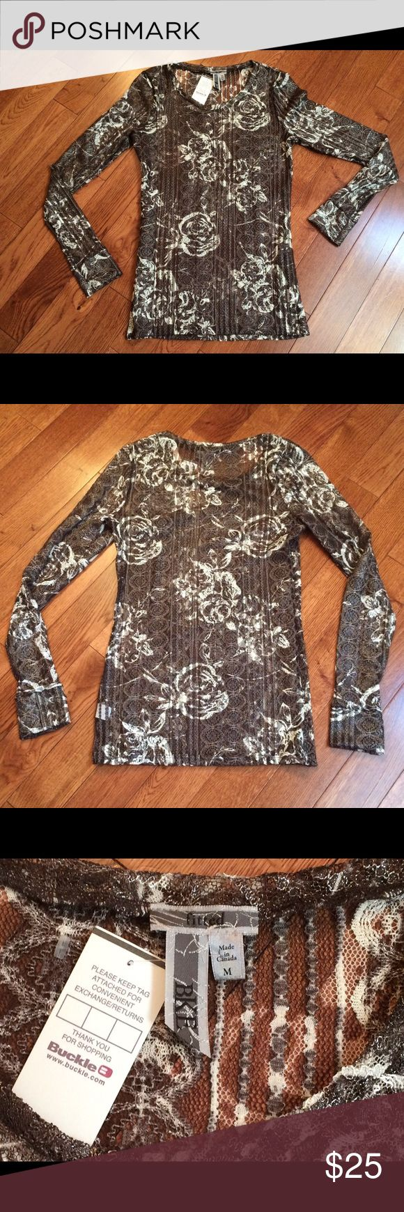 BKE Fitted Lace Top from Buckle BKE Fitted Black & White Lace Top  From The Buckle Store. Women's Size Medium but Fits More Like a Small. New With Tags. Gorgeous Top for a Night Out! BKE Tops Blouses