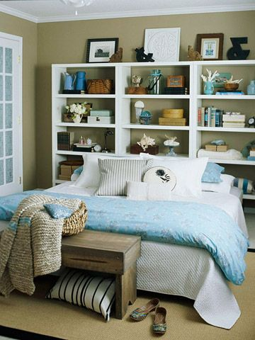 small bedroom | Bookcase Headboard: Positioned behind a bed, a wall of bookshelves becomes a decorative miracle worker—it's a headboard, focal point, and display unit all at once. Employ one of the shelves as a bedside table with an alarm clock and reading lamp. Then fill in the rest of the shelving with treasured collectibles, books, or family photos
