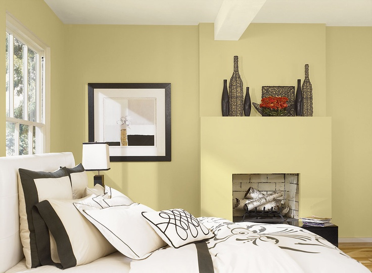 Benjamin Moore Paint Colors - Yellow Bedroom Ideas - Light, Relaxed Yellow Bedroom - Paint Color Schemes . . . . . Use Bronzed Beige to create a serene, tranquil retreat. . . . . . Walls - Bronzed Beige (2151-50); Ceiling - White Lightning (2019-70); Accent (flower blooms) - Morrocan Spice (AF-285).