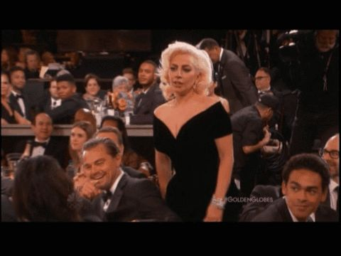 Leonardo DiCaprio had a hilarious reaction when winner Lady Gaga bumped into him on her way up to the podium at the Golden Globes 2016 on Sunday, Jan. 10 -- watch now!