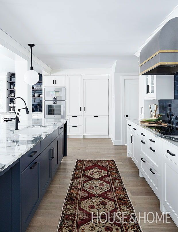 Indigo Backsplash Tiles And A Deep Blue Island Visually Ground This Halifax Kitchen And Gi Kitchen Lighting Remodel Beautiful Kitchen Cabinets Nautical Kitchen