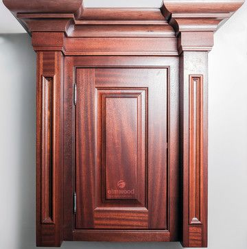 """*Moulding Monday* Recessed Alexandria pilasters on either side of this cabinet with our Geneva door in Mahogany, Cabernet stain finish. EK21 moulding is used with EK32R sub-moulding with our """"N"""" edge."""