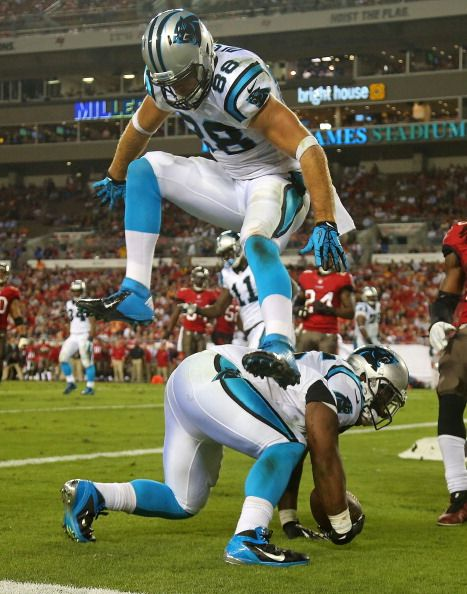 TAMPA, FL - OCTOBER 24: Mike Tolbert #35 of the Carolina Panthers dives for a touchdown as Greg Olsen #88 jumps over him during a game against the Tampa Bay Buccaneers at Raymond James Stadium on October 24, 2013 in Tampa, Florida. (Photo by Mike Ehrmann/Getty Images)