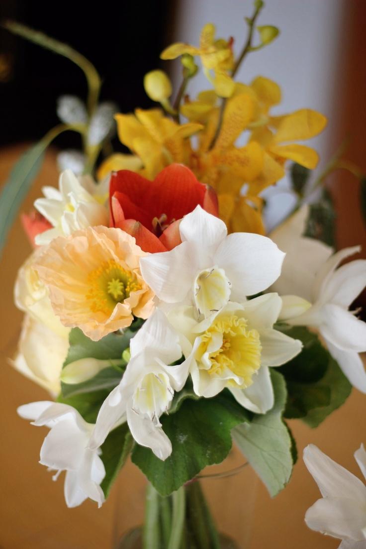 Bridesmaid bouquet by @floretcadet (www.floretcadet.com) Mokara orchids, eucharis lilies, icelandic poppies, amaryllis, eucalyptus pods #poppies #orchids