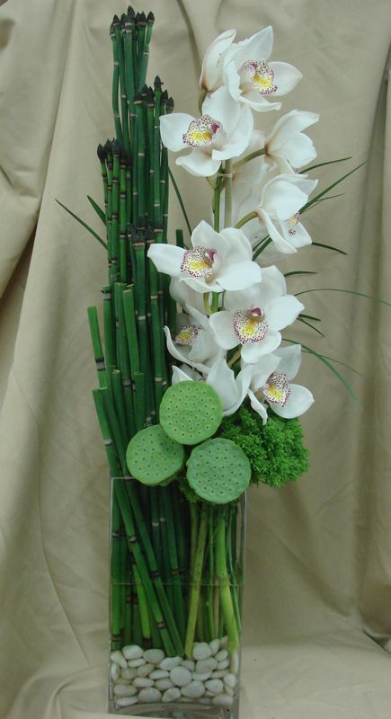 This is an arrangement featuring white cymbidium orchids.  See our entire selection at www.starflor.com.  To purchase any of our floral selections, as gifts or décor, please call us at 800.520.8999 or visit our e-commerce portal at www.Starbrightnyc.com. This composition of flowers is generally available for same day delivery in New York City (NYC). OR113
