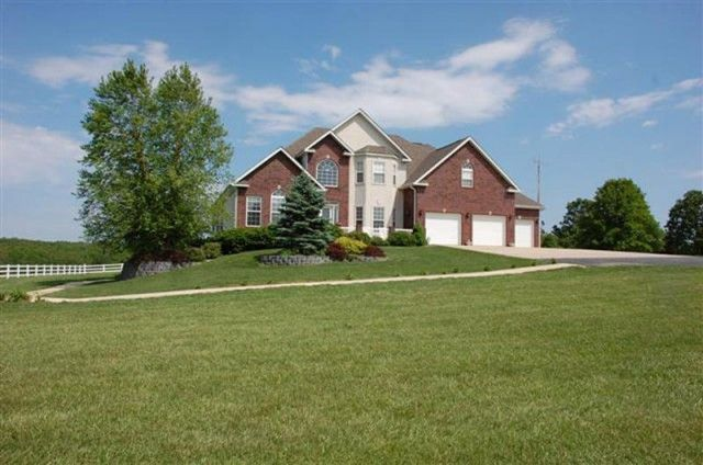FOR SALE IN WEST PLAINS, MO: Custom built, executive brick home on 9 captivating acres in the Heart of the Ozarks. This stunning 2 story home in Howell County includes 5 bedrooms & 4.5 baths and features cherry cabinetry, custom kitchen with granite countertops, double dishwashers, breakfast bar & walk-in pantry; formal dining room, living room & office; 3 fireplaces; hearth room; sunroom over looking in ground pool & patio; finished walkout lower level with separate living quarters.
