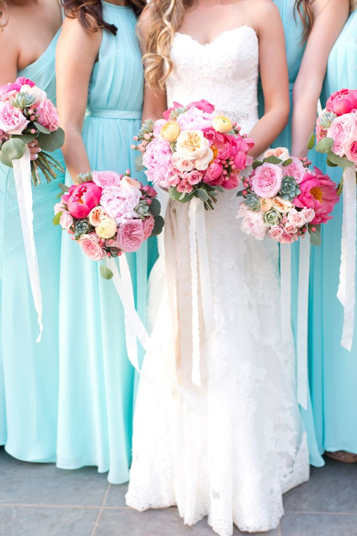 Bright and colorful Soho 63 summer wedding. There were pops of color every where at this pink and aqua wedding and just enough muted green in the succulents and eucalyptus leaves to make it perfection! The bouquets were lush pink and white peonies, with touches of yellow and green. And the bridesmaids wore long flowing chiffon light turquoise dresses.