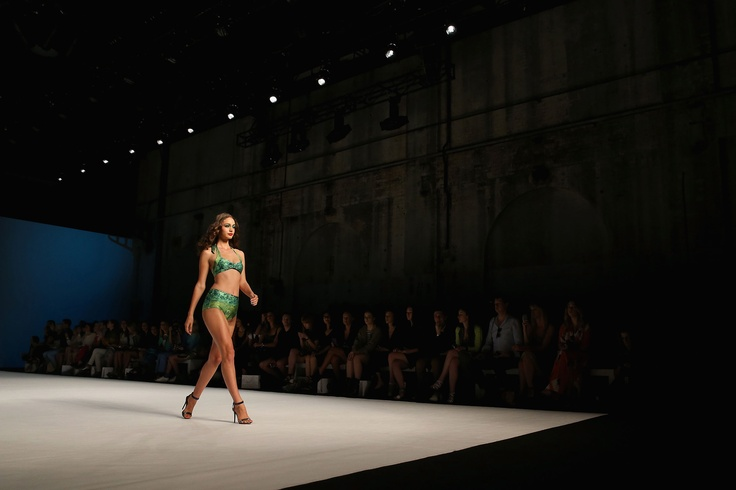 A model showcases designs on the runway at the We Are Handsome show during Mercedes-Benz Fashion Week Australia.