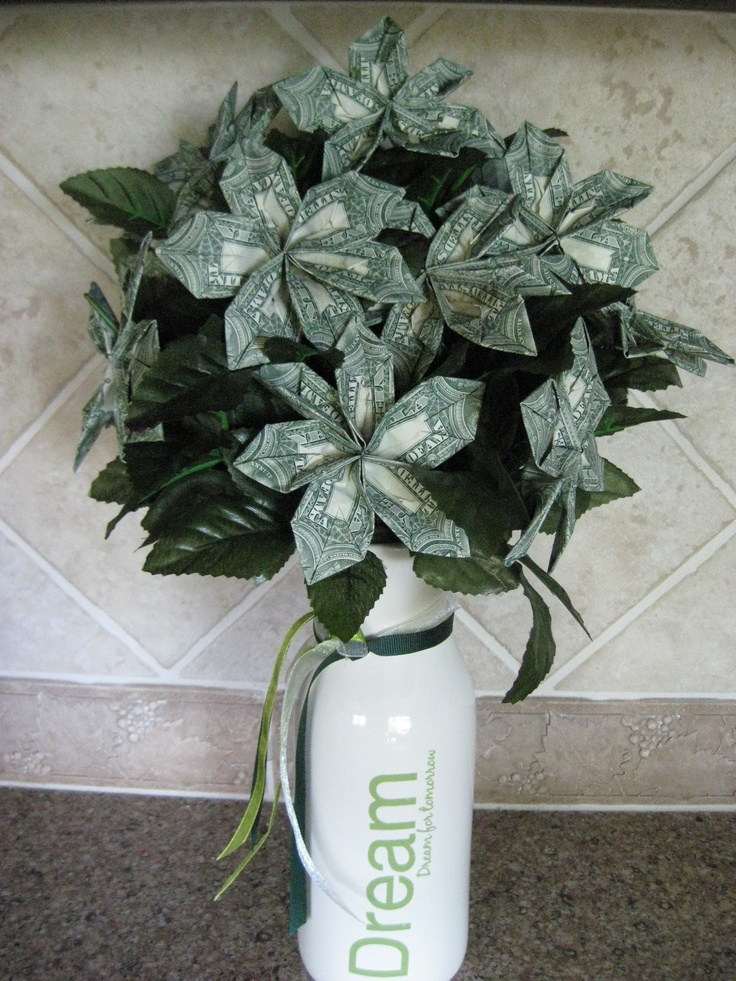 I made this money flower bouquet for my granddaughter.  It is so easy.  To create it, go to www.homemade-gift...
