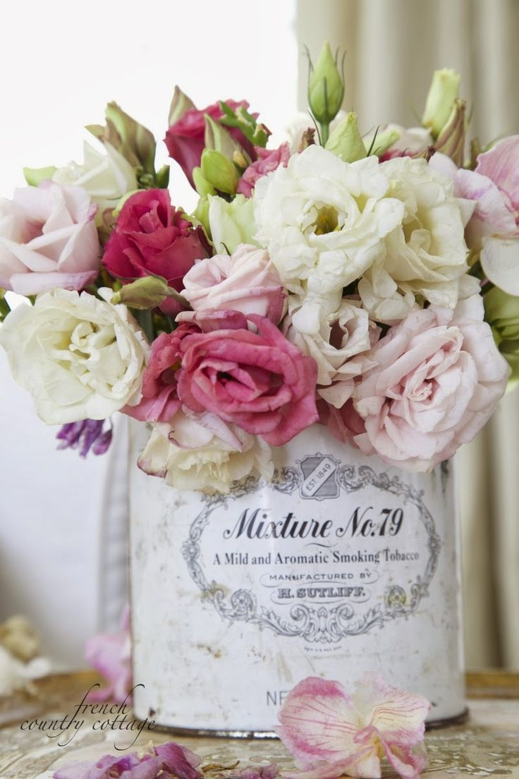 FRENCH COUNTRY COTTAGE: Old tobacco tin vase If it's roses...I love it!
