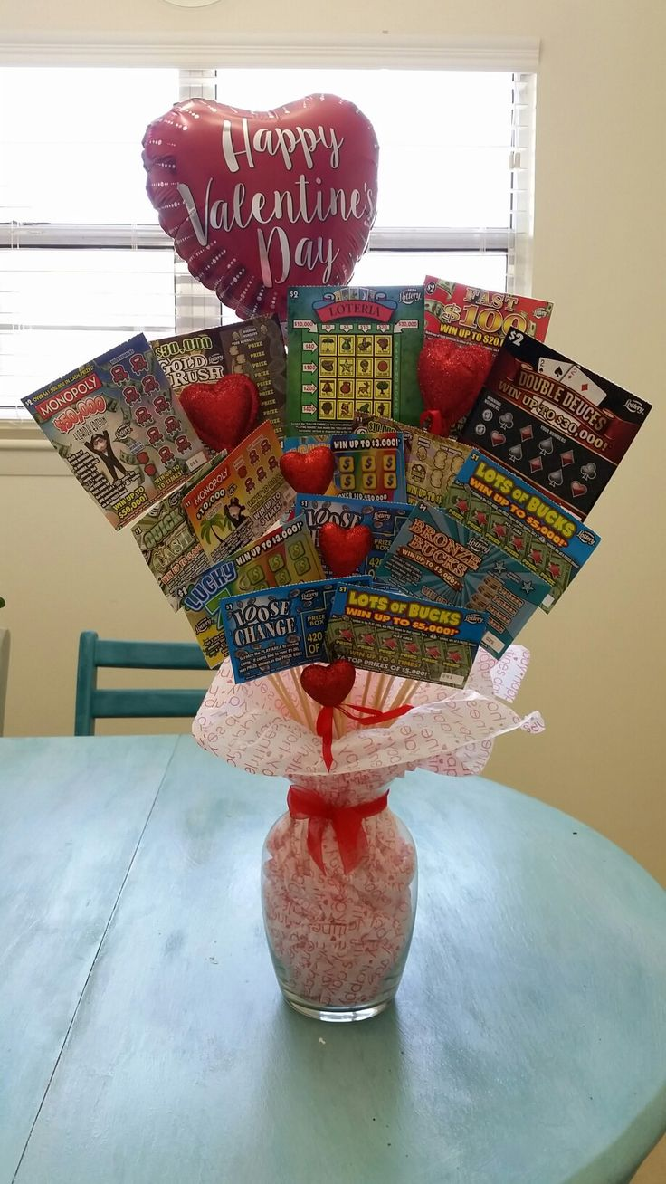 Made this lottery ticket bouquet for my husband for Valentine's Day this year! Works great for any occassion!  Supplies -Lottery tickets -Skewer sticks (walmart) -green foam (Dollar Tree) -vase (Dollar tree) -glitter hearts (walmart) -tissue paper -misc decor pieces  Pretty self explanatory, just wanted to share what I used and where I found them. Have fun making it for your special ocassion! 😀