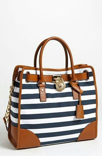 Michael Kors nautical inspired hand bag, great with an all navy/white outfit and tan loafers...