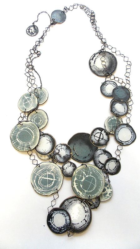 """AMANDA DENISON Contemporary Jewellery. """"I am influenced by the urban environment.  I am intrigued by the traces left behind through decay, dilapidation and dereliction, and by the fragments of what once existed.     My fascination with texture and surface pattern translates into my jewellery.  I work with mixed metals - mainly silver and copper, and enamels.  Different techniques are used to create textured metal surfaces which are then enamelled or etched."""""""