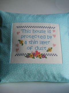 How to turn your stitching into a cushion! (love the saying on the cushion...LOL)