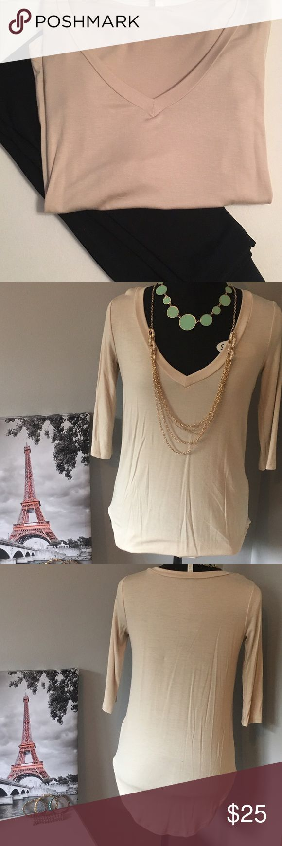🆕Oatmeal Half Sleeve Top This is a 3quarter Sleeve Top and features a v-neck design. Oatmeal in color. Not see through but a great material for winter or spring. Pairs great with leggings. chiccouture Tops Blouses