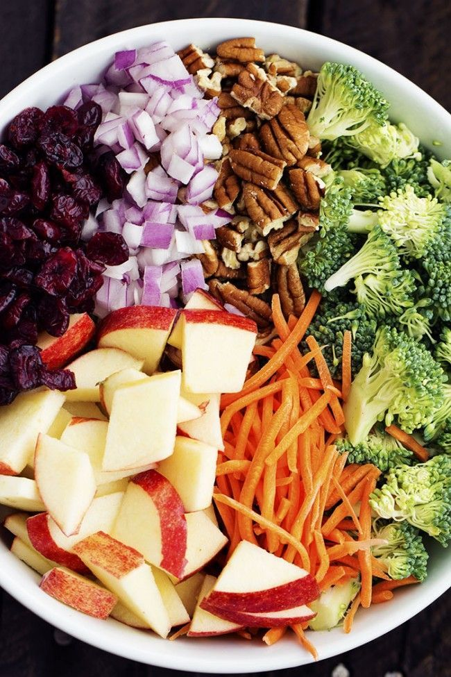In a large bowl combine broccoli, carrots, red onion, apples, pecans, and dried cranberries. To make the dressing: Whisk together mayonnaise, greek yogurt, lemon juice, sugar, salt and pepper. Add the dressing to the salad and toss to coat. Chill until ready to serve.