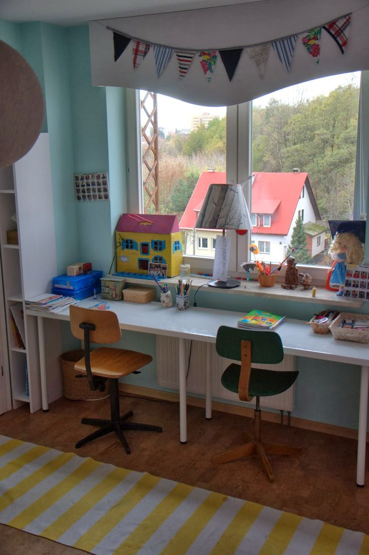 girls white desk and vintage school chairs