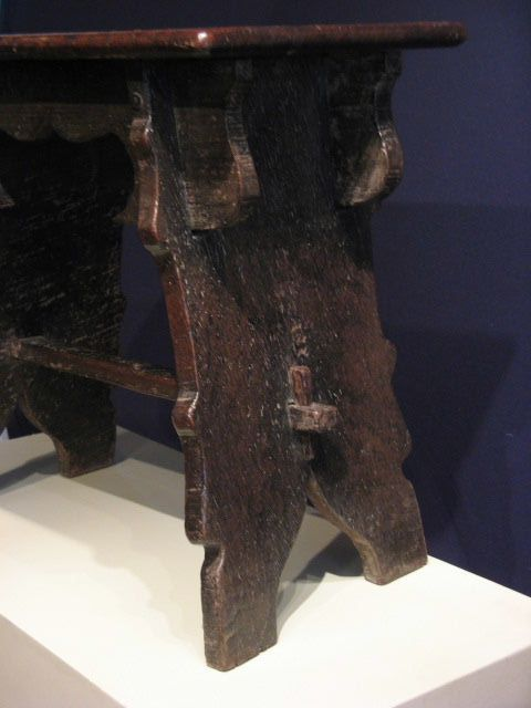 "EARLY 17TH CENTURY OAK BOARDED STOOL. ENGLISH .CIRCA 1600. THE SINGLE PLANKED TOP ABOVE SHAPED FRIEZES ,WITH PLANKED ENDS, JOINED BY A STRETCHER. 20.5"" HIGH X 21"" WIDE X 13"" DEEP."