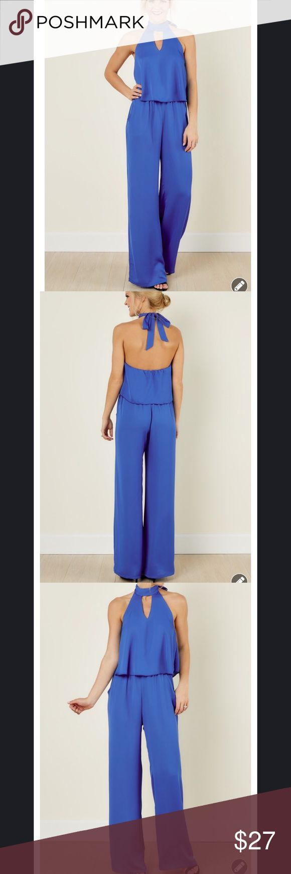 "Blue Jumpsuit NWT. Pet and smoke free home. This jumpsuit features a halter neck, elastic waistband, and a v front cut out. Length- 60.5"", bust- 38"", waist-30"" (has stretch), hips-46"", inseam- 41"" Red Dress Boutique Pants Jumpsuits & Rompers"