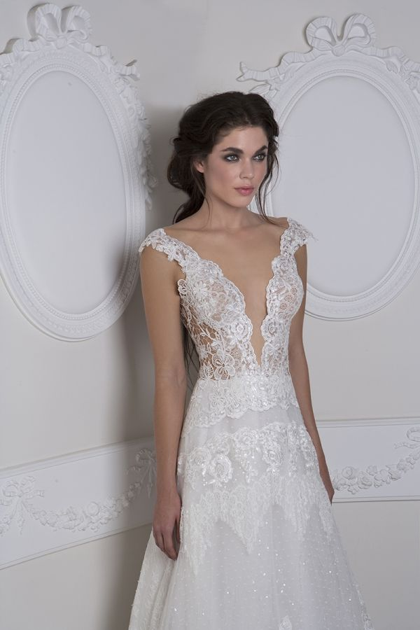 White A-line gown with a combination of Guipure lace and tulle with an extra layer of sequins on the skirt