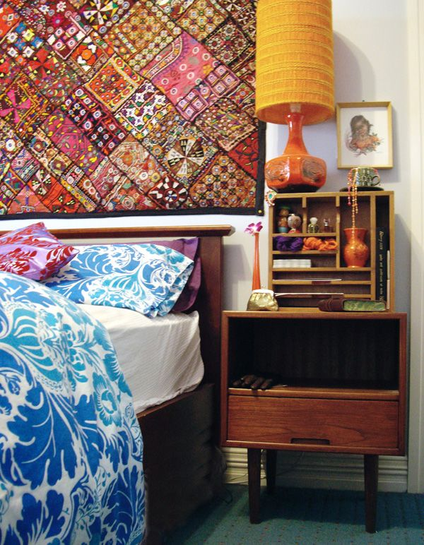 quilt for a headboard (the bedside table is pretty cute, too..)