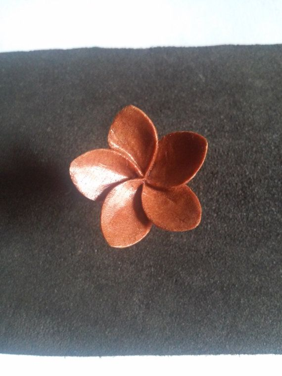 Check out this item in my Etsy shop https://www.etsy.com/listing/268340922/stud-earrings-wooden-plumeria-stud