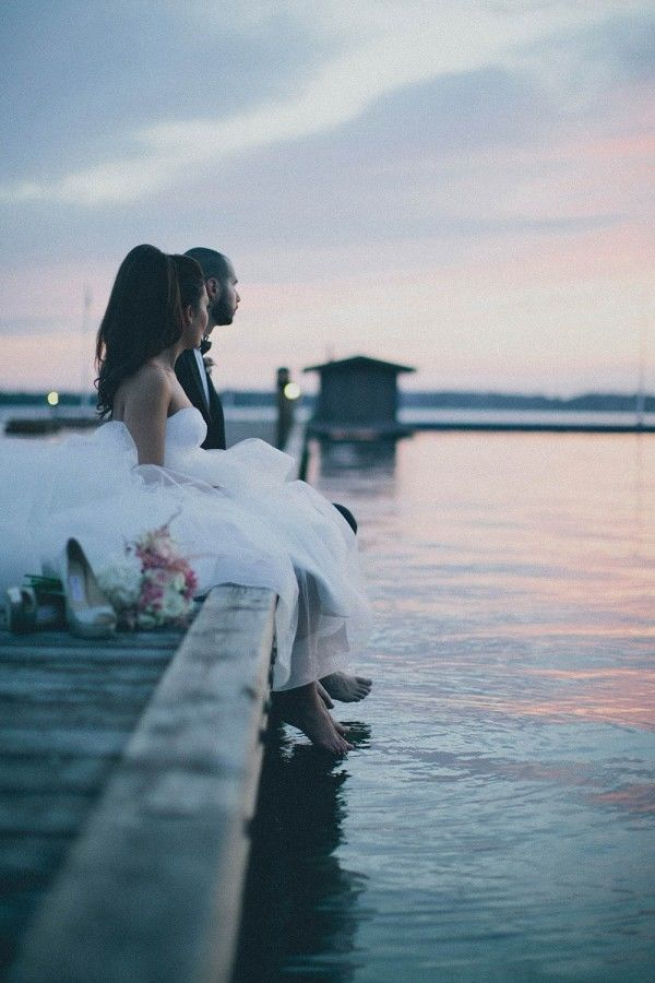 Waterfront Wedding Photo: Sometimes all you need is some natural lighting to capture a moment that will forever define a day, a couple, and a marriage. This lakeside photo shows a perfect serenity shared by just the two of them.