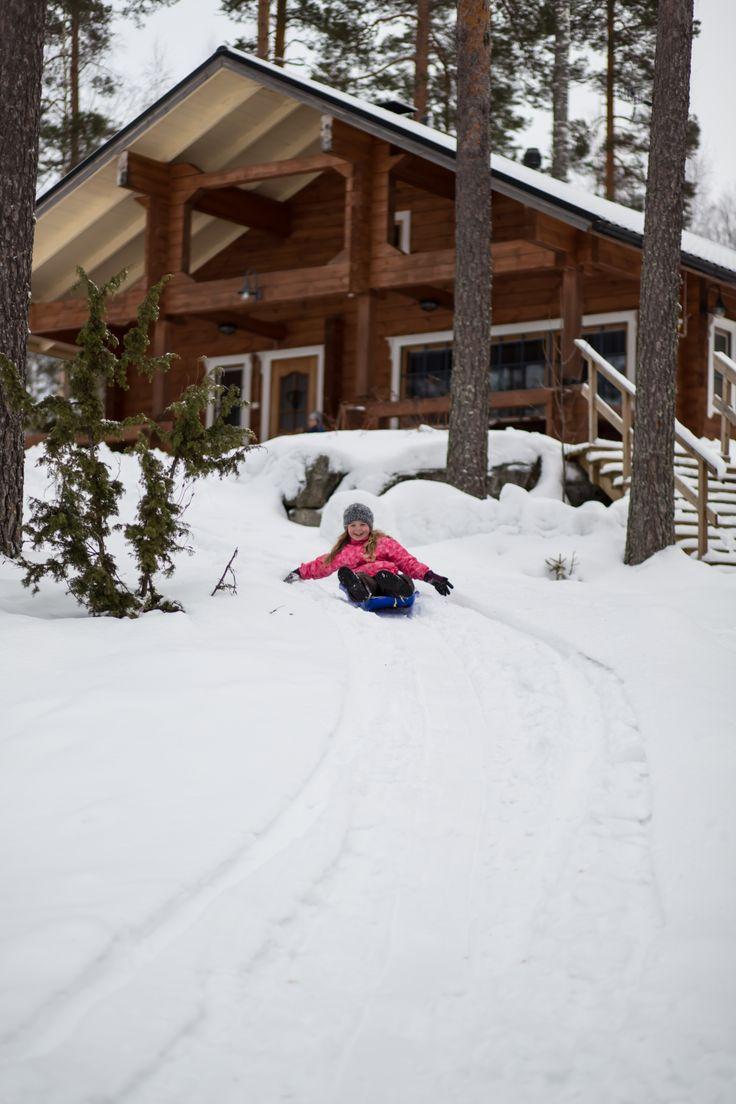 Riding on snow slides near the cottage Tiilikka