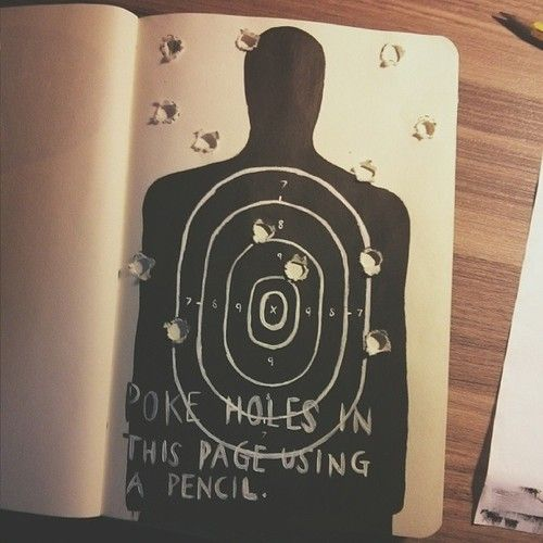 draw a bulls eye and fill up a balloon with paint and drop it. Put bulls eye in middle of two pages