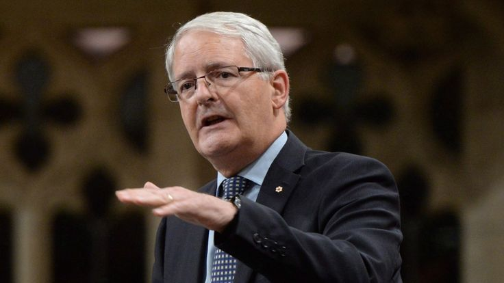 Transport Minister Marc Garneau issued a pointed warning Thursday to all airlines operating in Canada: forcibly removing passengers from overbooked airplanes will not be tolerated by the federal government.