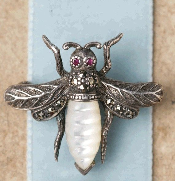 Antique French bee brooch. Materials: silver, marcasite, mother of pearl, ruby (Sold by metroart on Etsy)