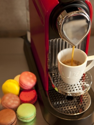 Nespresso: The art of Espresso... the secret behind the flavors belongs in the capsule.