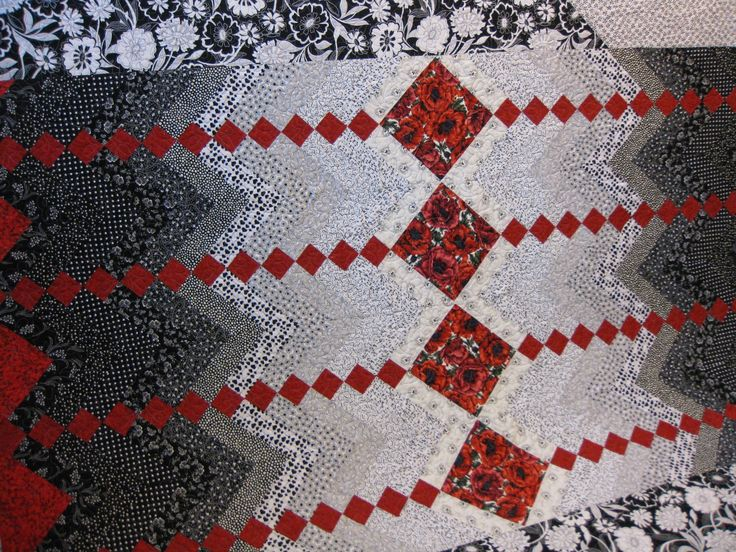 black and red quilts to make | The red makes the black and white fabrics pop.