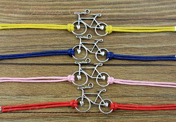 Bicycle bracelet, antique silver bike, 16 kinds of color, wax rope, bicycle party the best gift on Etsy, $0.99 .... Perfect for Lizzie's first birthday!