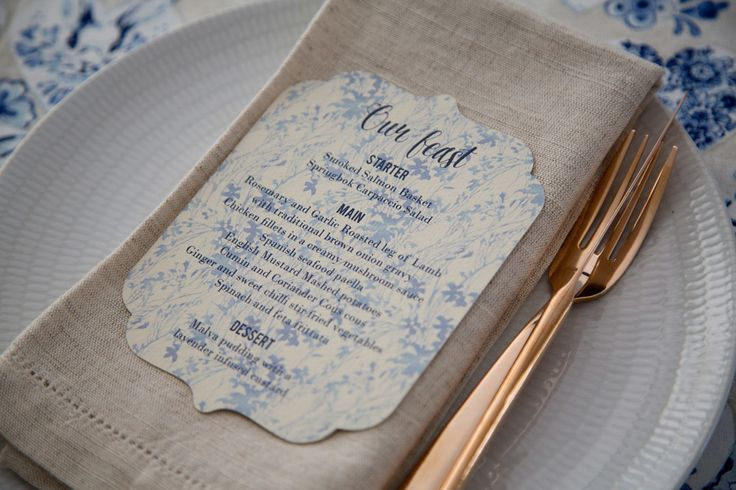 Blue and white delft scalloped edge wedding menu. Styling by Jani Venter. Photo by Rikki Hibbert.