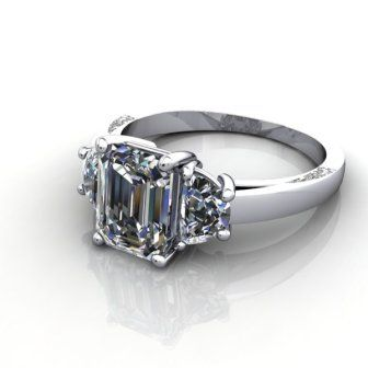 A gorgeous 3 stone engagement ring design featuring an emerald cut diamond flanked by 2 half moon shoulder diamonds.