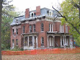 The mansion was completed in 1871.[8] It is a three-story red brick and white building, with white pillars supporting the porch. It contains 16 rooms and a vaulted wine cellar.  Situated on Alby Street on a site of 15 acres (61,000 m2), one of the highest points in Alton,[8] McPike named the estate Mount Lookout.[9] McPike was an avid horticulturalist and added extensive gardens with orchards, shrubs and rare trees.[9] Only 4.4 acres (18,000 m2) of the original estate remain of Mt…