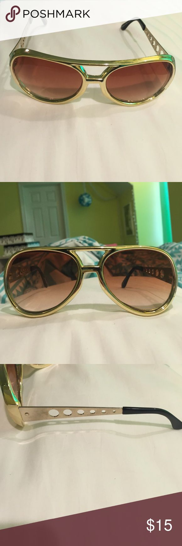 Elvis style gold aviator sunglasses Bought at Graceland these Elvis style sunglasses are OP. Gold aviators THAG are gently used Accessories Sunglasses