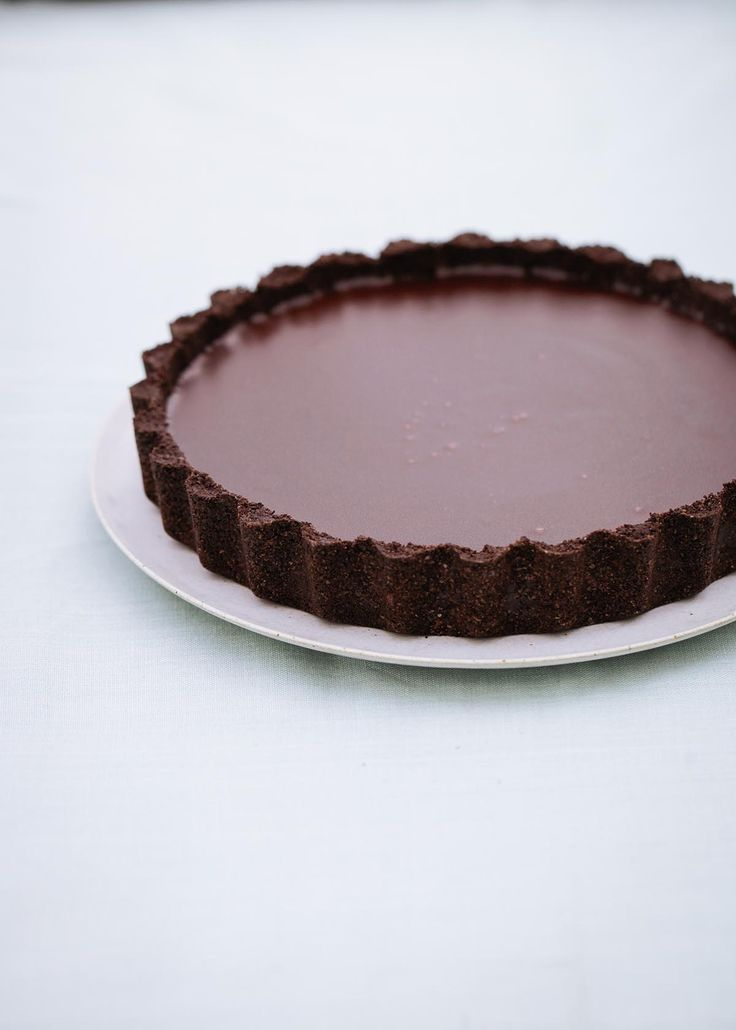 I have always avoided making chocolate tarts, not out of laziness (I love a bit of pastry-making, in the right mood), but because I have never really felt that the pastry served the chocolate, or was worth the effort here. This is my simple solution: make a base out of chocolate biscuits. And the filling is just as easy to make, too. Not that you'd know from the taste. I never lie about how effortless something is to make, but no one will believe me on this one. I think the hit of salt is…