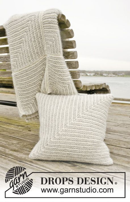 """Set consists of: Knitted DROPS blanket and pillow with domino squares in """"Cloud"""". ~ DROPS Design"""